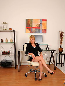Sexy secretary is damn hot as she flashes her sheer white thongs under her business attire