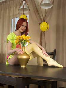 Hot teen babe teases and poses in her sexy yellow nylon stockings before fingering her sweet wet pus