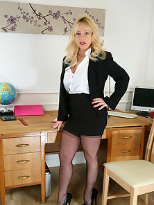 Naughty Blonde Babe Shows Her Nice Cleavage and Big Ass an the Office