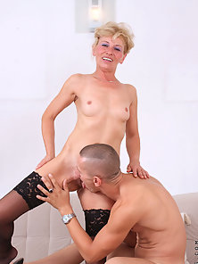 Sex starved blonde milf gags on the stiff cock of a young stud before she gets an intense fucking