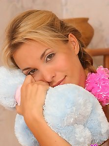 Cute blonde Silvia poses with her favorite teddy bear and reveals her sweet, most intimate spots.