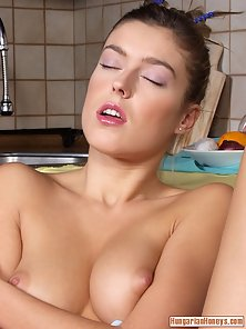 Christine Zaflarska in high heels toying herself with a corn dildo