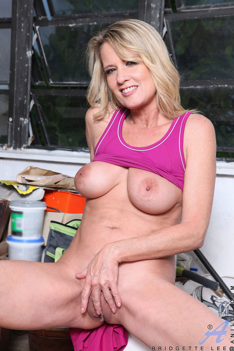Soccer Mom Bridgette Lee Shows Off Her Big Tits And Shaved Milf Pussy