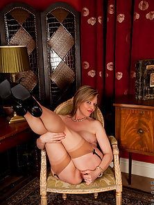 Louise Pearce plays her violin naked with just stockings on