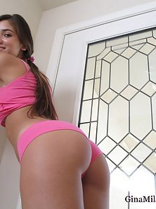 Young flirty Gina Milano shows off her ass cheeks