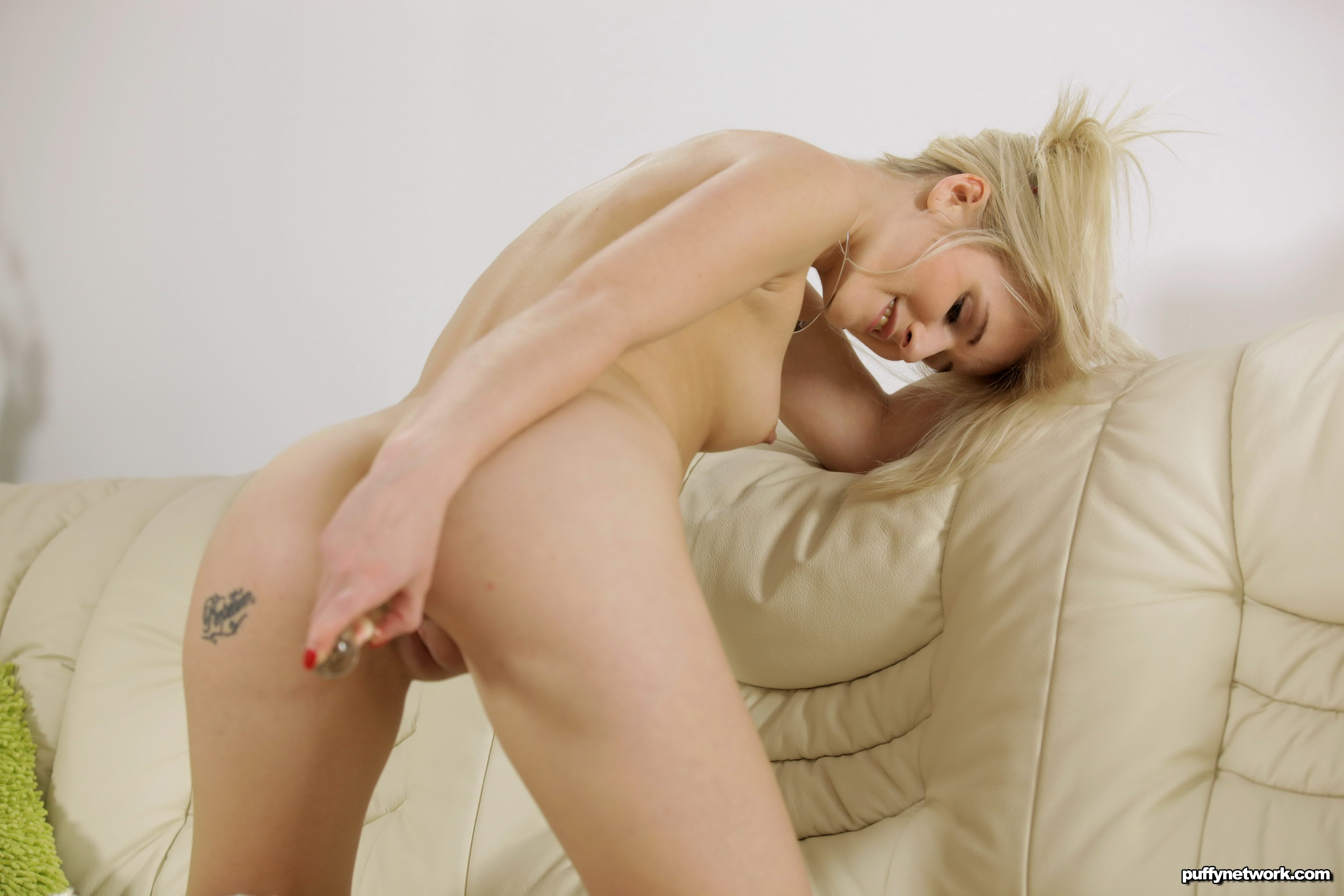 Cute blonde likes showing her pussy photos