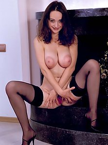 Busty girl in stockings plays with her tits and fingers herself