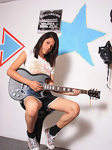 A sweet adroable Latina teen plays guitar and gets naked