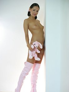 Sexy teenage beauty playing with her stuffed white bunny