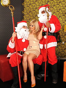 Suprised blonde babe fucked by two horny Santas