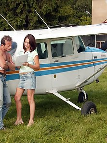 Brunette teenie gets her ass fucked near their tiny plane