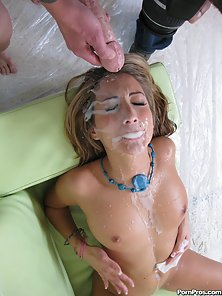 Hot chick is caught by surprise when she's jizzed on