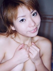 Shy Japanese amateur coed shows her pussy