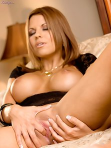 Nicole strip teases and starts fingering her red hot pussy.