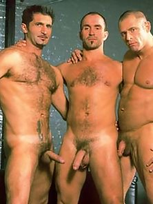 A team of hardcore leather studs take turns nailing their buddy in a sling