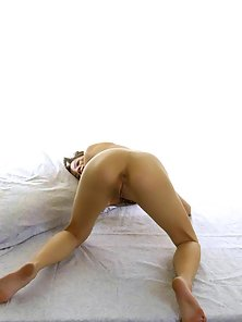 Sweet asian chick shows her tiny shaved pussy