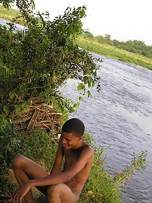 Latino boy swimming in the river naked and jack