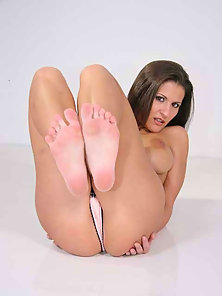 Hot brunette slim gets a gob of goo shot on her pretty toes