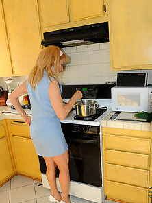 Hot mom makes dinner in her sexy dress and white high heels