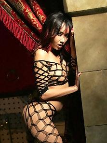 Hot skinny asian girl showing her perky breasts with hard nipples