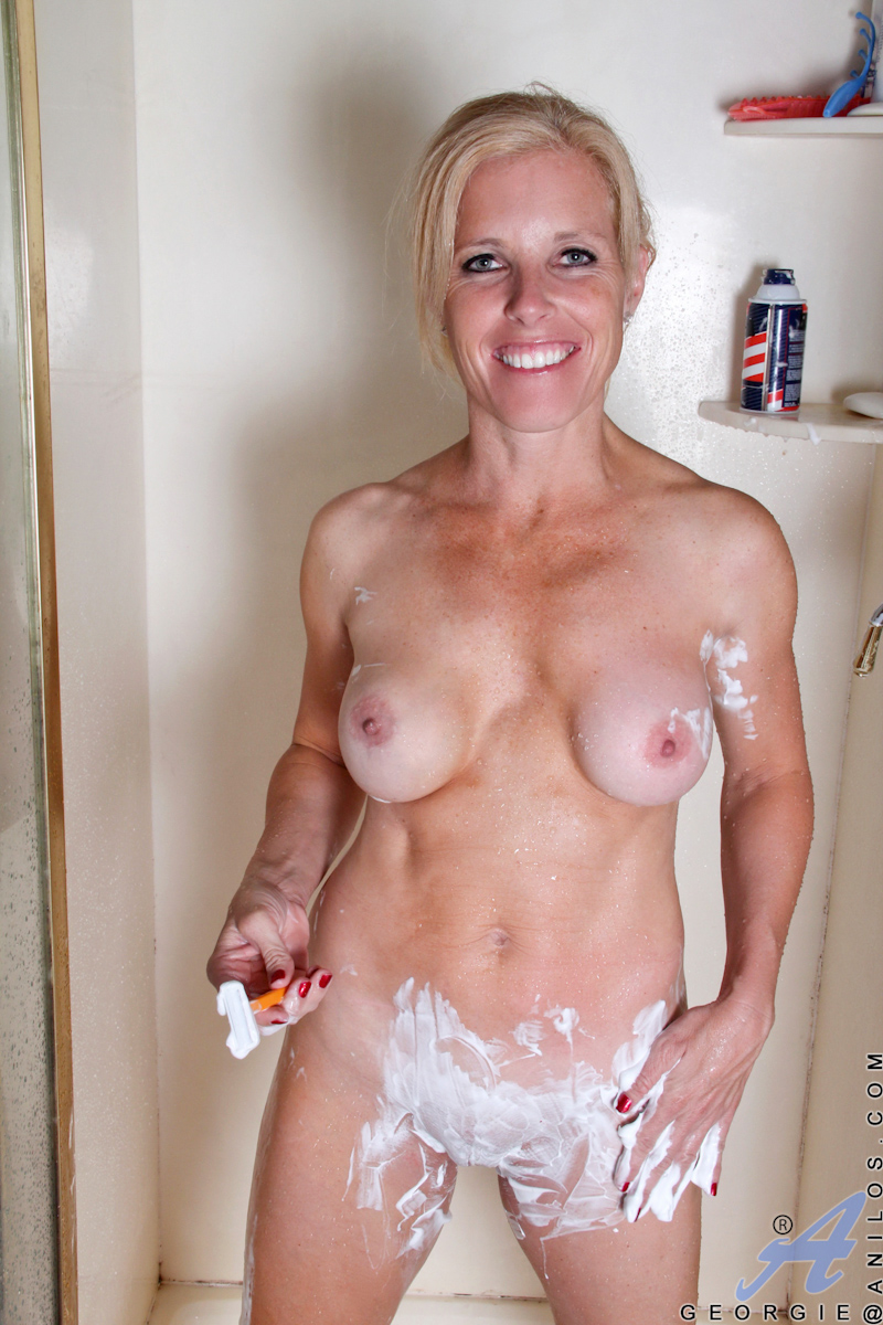 Sexy Blonde Cougar Wets Her White Tshirt And Fingers Her -3689