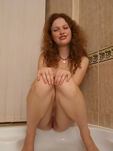 Very cute teen girl gets herself off in shower