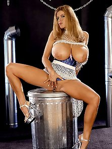 Attractive Blonde With Enormous Fun Bags Shows Her Pink