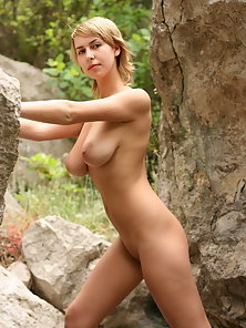 All natural busty blonde russian exposes it all outdoors.