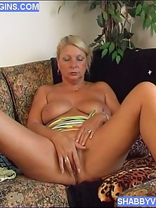 Mature blonde toys clean shaved pussy with dildo