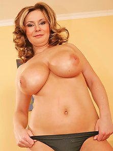 Milf Bianca showing her huge tits and fingering.