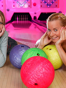 Two teenage cuties toying their juicy pussies after bowling