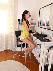 Dinara is a young and perky sexy woman who is doing her makeup today.