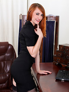 Cougar Holly Jane takes a break at the office to pleasure her pussy
