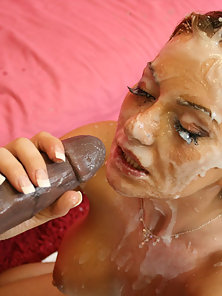 Doggystyle sex on the couch leads to a huge facial cumshot
