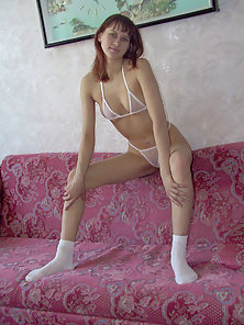 Tight chick takes it all off except her cute little socks.