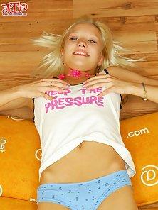 Sweet smiling blonde teen shows off her fresh body and sticks a vibrator inside her pussy.