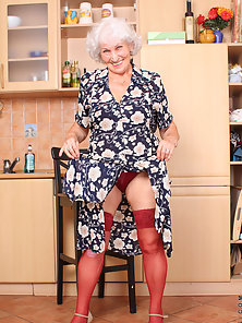 Naughty Anilos granny takes off her panties and stimulates her experienced gray haired pussy with he