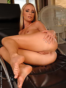 Natural blonde beauty Dorina dildoing on chair
