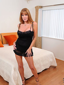 Milf housewife shows off her mature body in an alluring black bra and pantie set