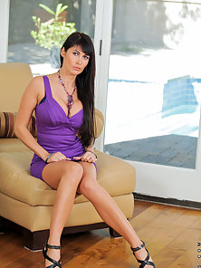 Classy milf Eva Karera wears sexy evening wear to get male attention