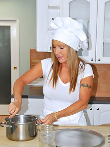 Anilos Luna is a sexy chef who enjoys baking in her sexy all white dress and high heels looking so y