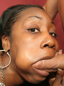 Gorgeous black babe with an oily ass sucking dick