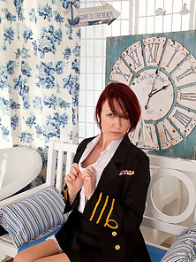 Redhead Anilos stewardess flaunts her big jugs in a bra