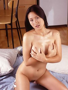 Busty Thai babe spreads her tight asian pussy