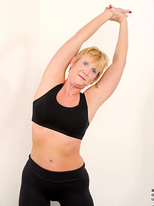 Sexy Anilos Honey Ray stretches her mature body while wearing tight fitness gear