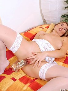 Uninhibited milf evelina marvellou drills her tight pink pussy with an enormous transparent dildo
