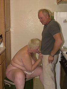 Huge blonde sucks a hard cock in the kitchen