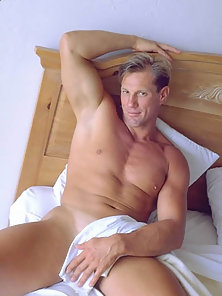 Showing off his bulging muscles and his hot bubble butt on the bed.