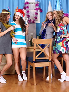 Four charming teen babes got naughty during the party and stripped naked for some lesbian fun.