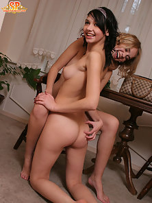Two striking girls are fond of spending time together when they are alone in the house so that they